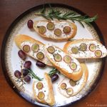 Soft Cheese Crostini with Pickled Grapes and Rosemary