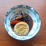 Small bowl of Taiwanese-Style Soy Sauce Eggs with Carrots, egg cut in half to show the inside